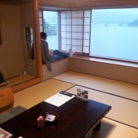 An image of a tatami room looking over Lake Kawaguchiko, Mt Fuji