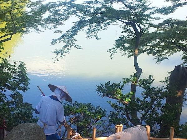 A gardener sweeping leaves at Kenrokuen garden, Kanazawa