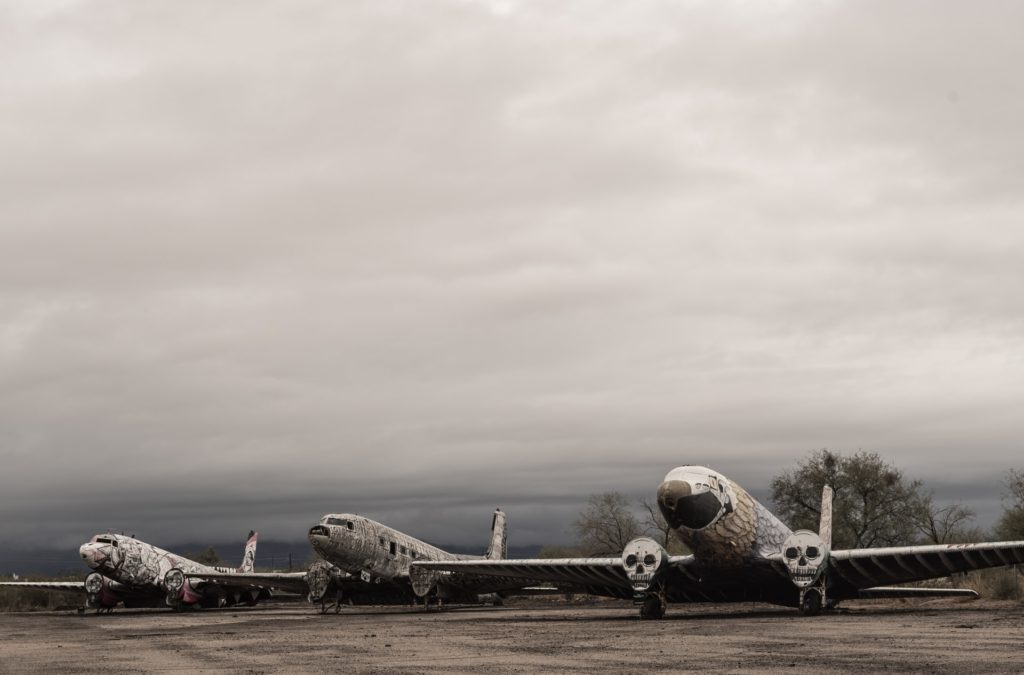 Three abandoned aeroplanes covered with illustrative art. Do they feel flygskam too?